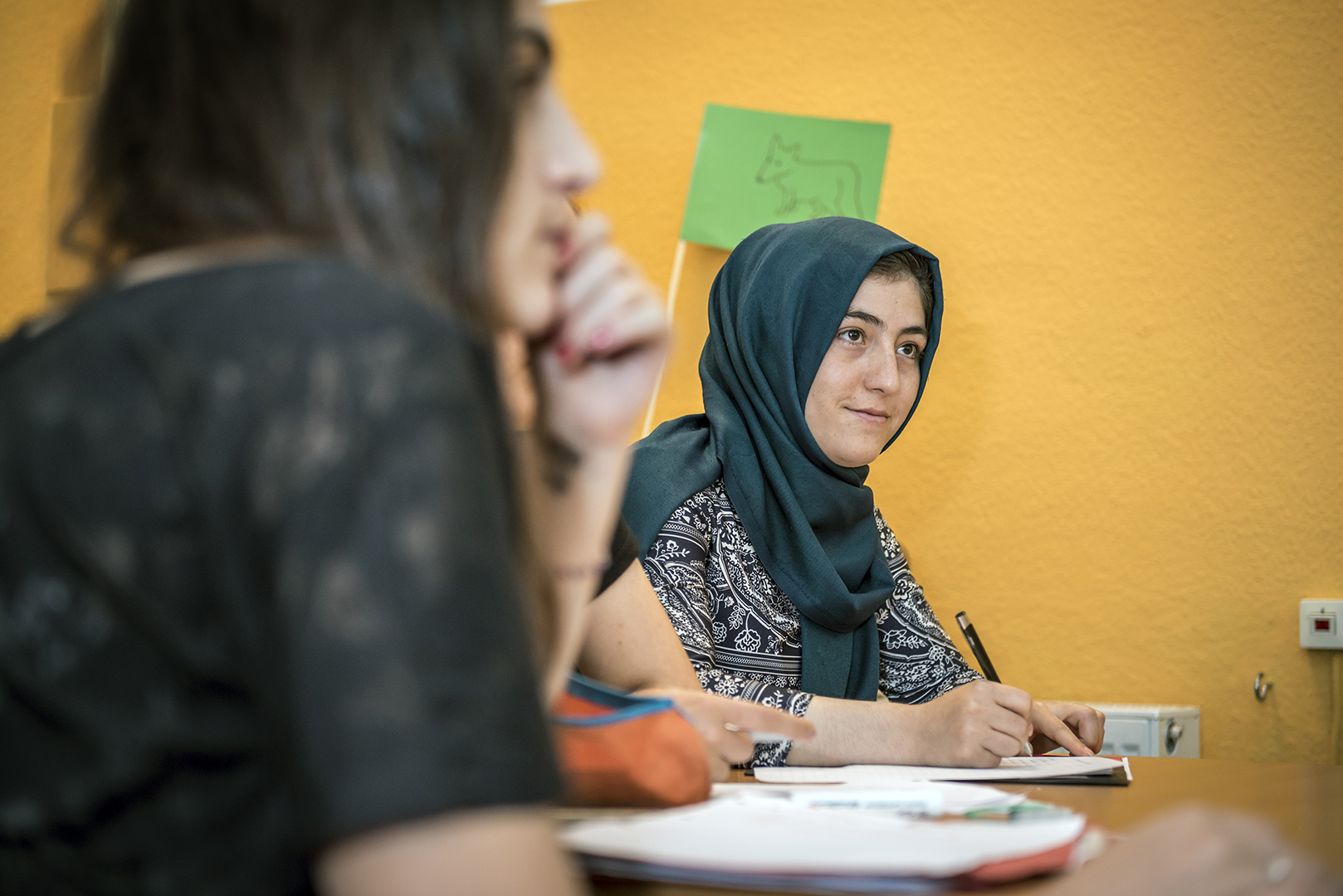 """Samira Marwi, age 15, from Afganistan, participant at the refugee summer school at """"lehrreich"""" in Berlin-Wilmersdorf. Samira lost both her parents at a young age. One day she wants to study medicine, but first she'll have to tackle the finer points of German grammar. Germany, Berlin, 29/08/2016"""