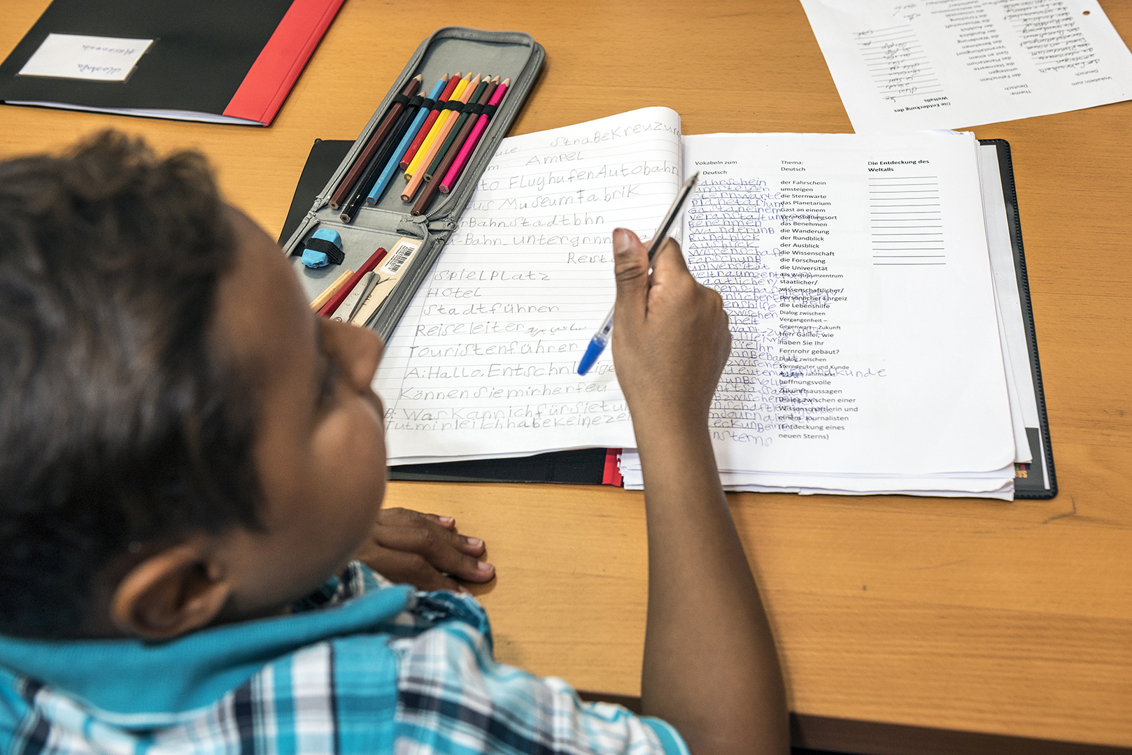 """Mahmoud Jad, age 13, from Syria, participant at the refugee summer school at """"lehrreich"""" in Berlin-Wilmersdorf. Mahmoud loves reading and writing. The new alphabet is difficult, he says, but playing games makes learning more fun. Germany, Berlin, 29/08/2016"""